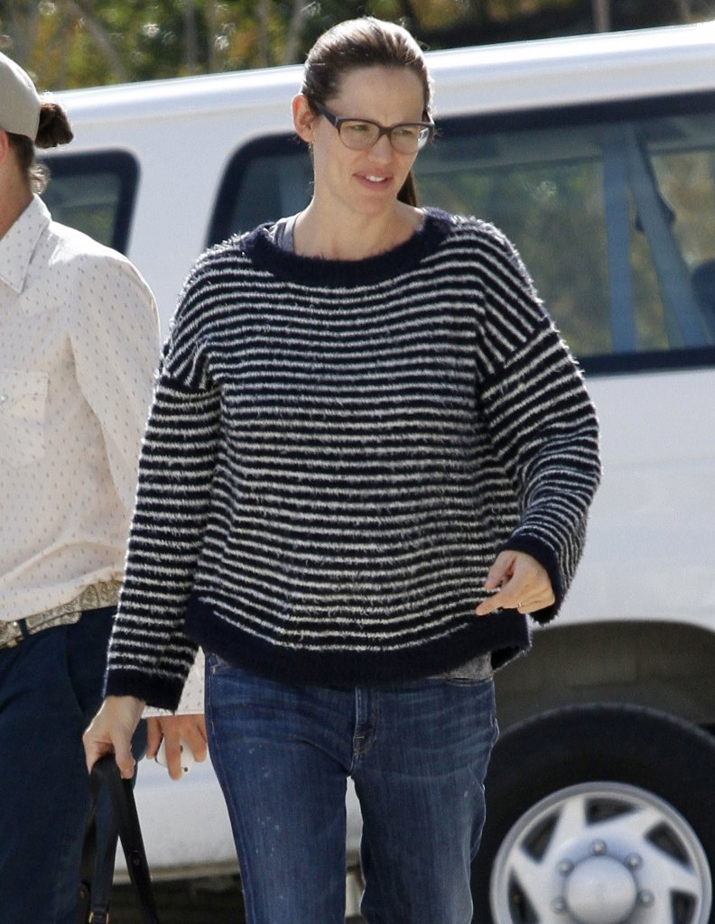 Jennifer Garner wore her glasses and her hair pulled up into a ponytail.
