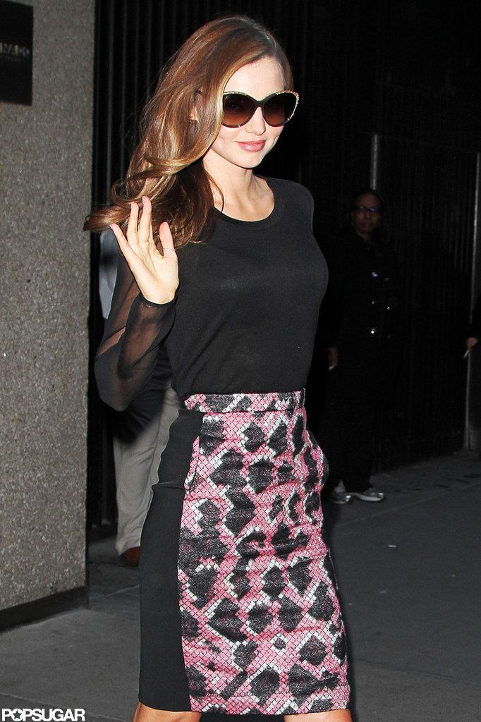Miranda Kerr sported sunglasses at night.
