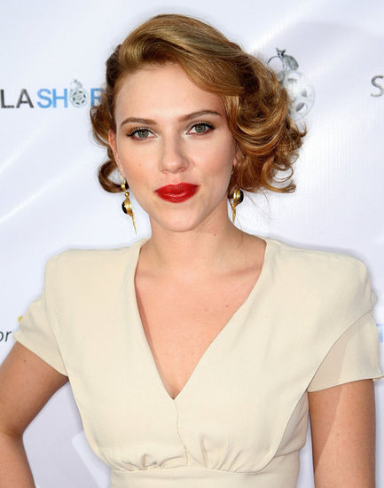 Trying her hand at Old Hollywood glamour, Scarlett opted for a vintage-inspired hairstyle paired with bright red lipstick.