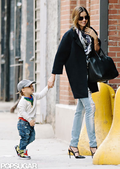 Miranda Kerr held hands with Flynn Bloom as he walked beside her in NYC.