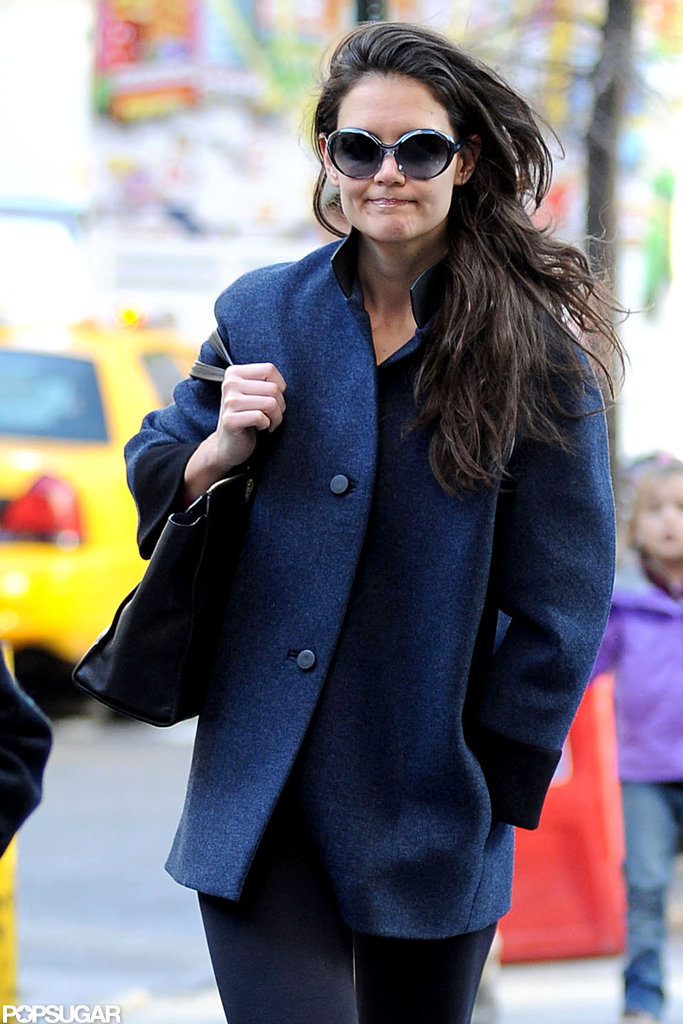 Katie Holmes stayed warm in a coat.