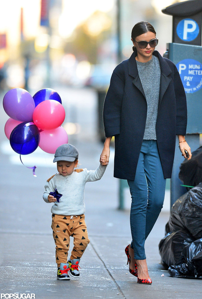 Miranda Kerr wore a black coat and heels for a walk with son Flynn Bloom.