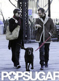 Anne Hathaway and Adam Shulman laughed while walking their dog.