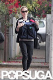 Anna Paquin held on to both of her babies as she took a walk.