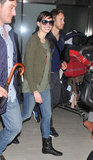 Anne Hathaway smiled as she landed with Adam Shulman.
