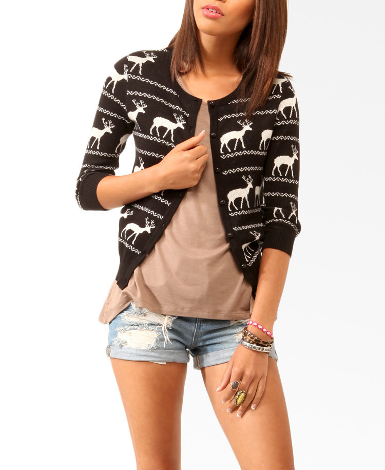 Slip this Forever 21 Reindeer Cardigan ($23) over a silky white blouse or fitted gray tee, and then tuck it into a pleated leather skirt.