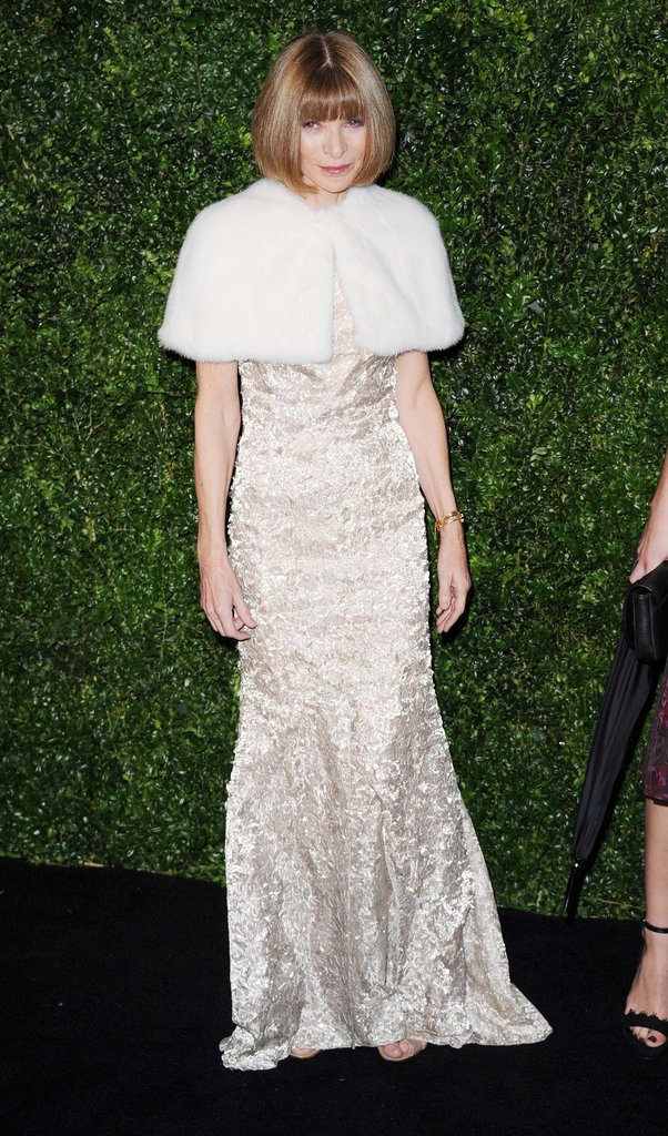 Anna Wintour looked like the snow queen wearing a shimmery light gold gown paired with a Winter-white fur stole.