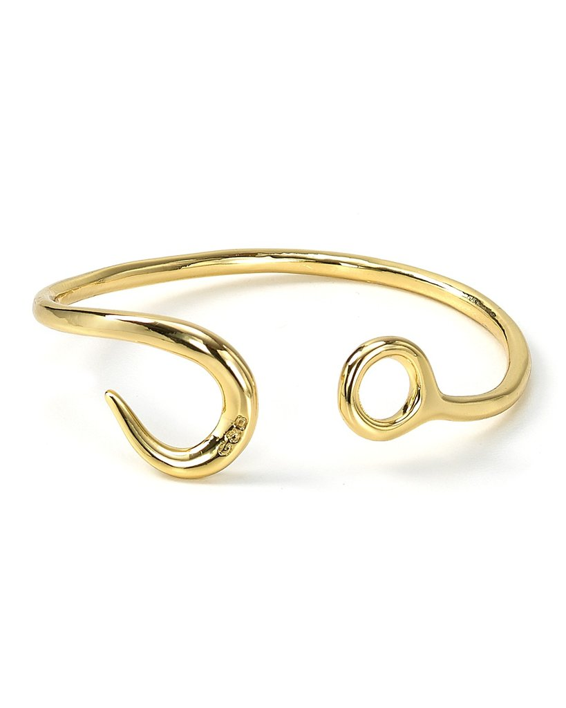 For the sartorial minimalist, we suggest this cutting-edge Giles & Brother hook cuff ($115).