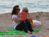Kourtney Kardashian brought a bathing-suit-wearing Penelope to the beach.