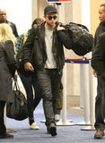 Robert Pattinson carried his bag at LAX.