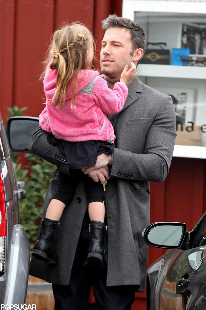Ben Affleck carried Seraphina Affleck to their car after the pair visited Brentwood County Mart in LA in November.