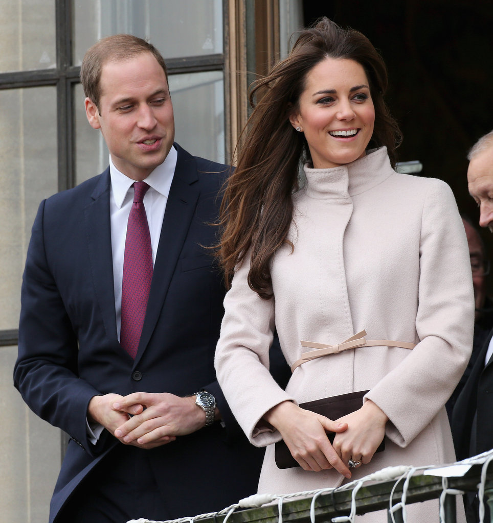 Prince William and Kate Middleton stood side by side on a balcony in Cambridge.