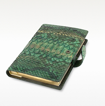 If your sis is a writer, then she'll be thrilled to scribble her thoughts in this luxurious green-and-gold python daily planner agenda ($219).