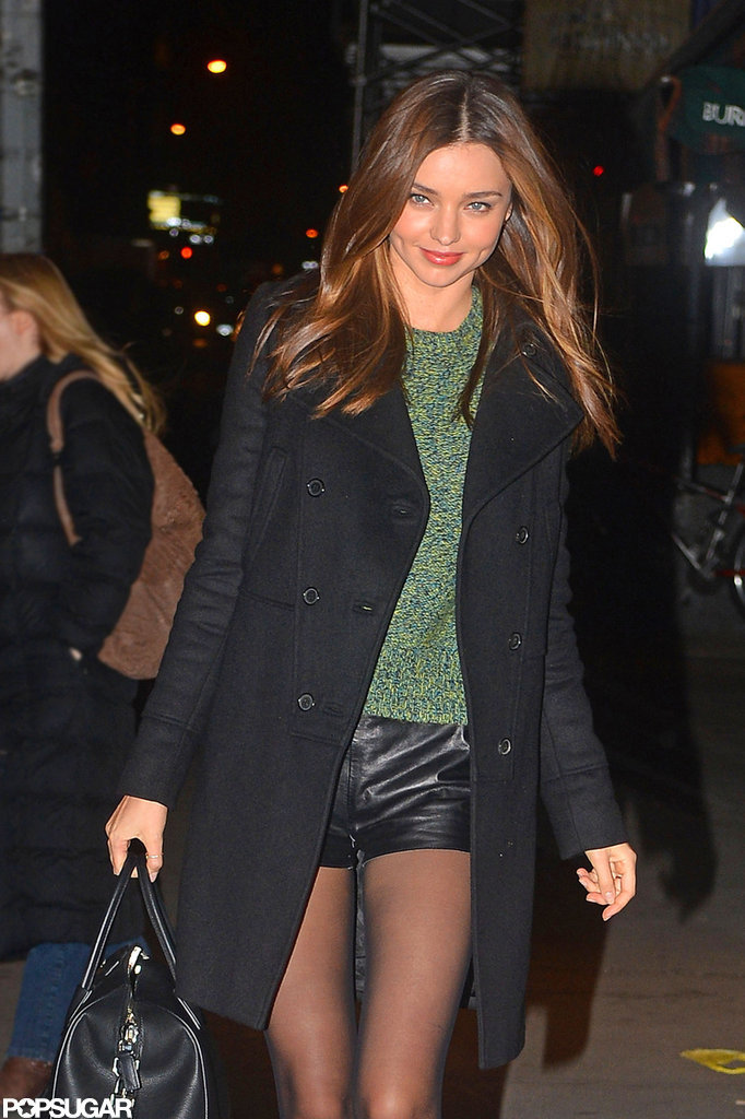 Miranda Kerr stayed warm in a coat and sweater.