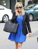 Reese Witherspoon wore a blue dress and blazer.