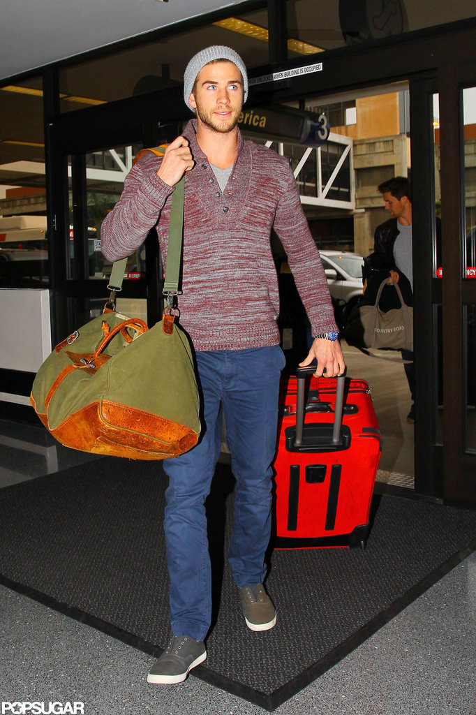 Liam Hemsworth traveled with two bags.
