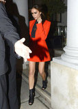 Victoria Beckham wore an orange blazer for the launch of a new Valentino exhibit in London.
