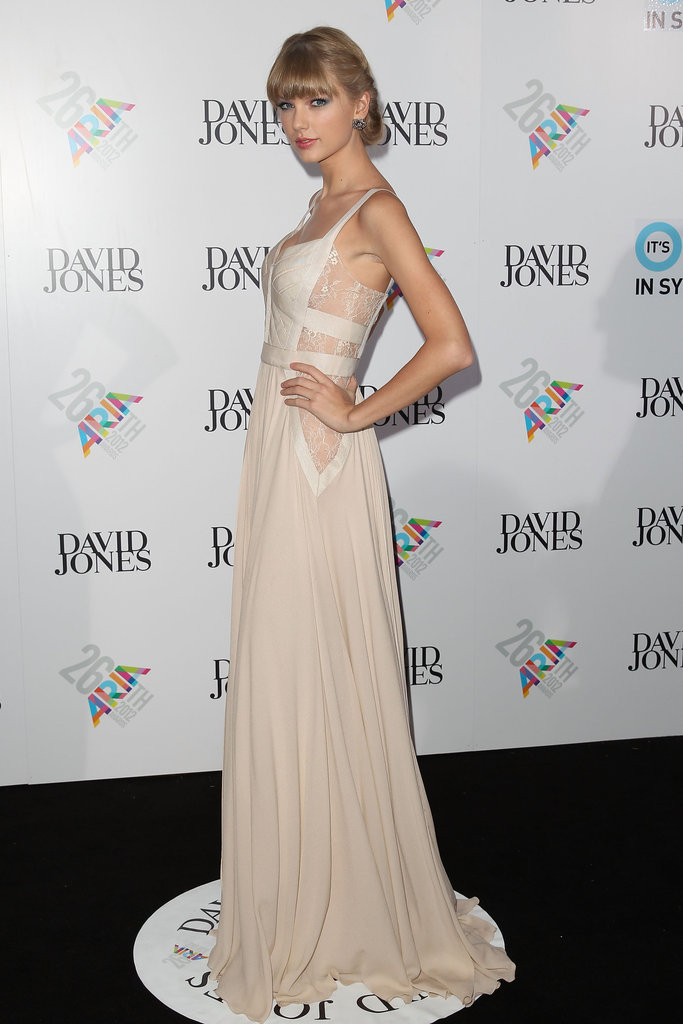 Taylor Swift wore an ivory Elie Saab gown.