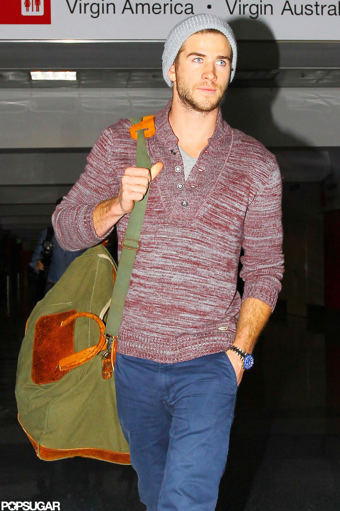 Liam Hemsworth carried his own luggage.