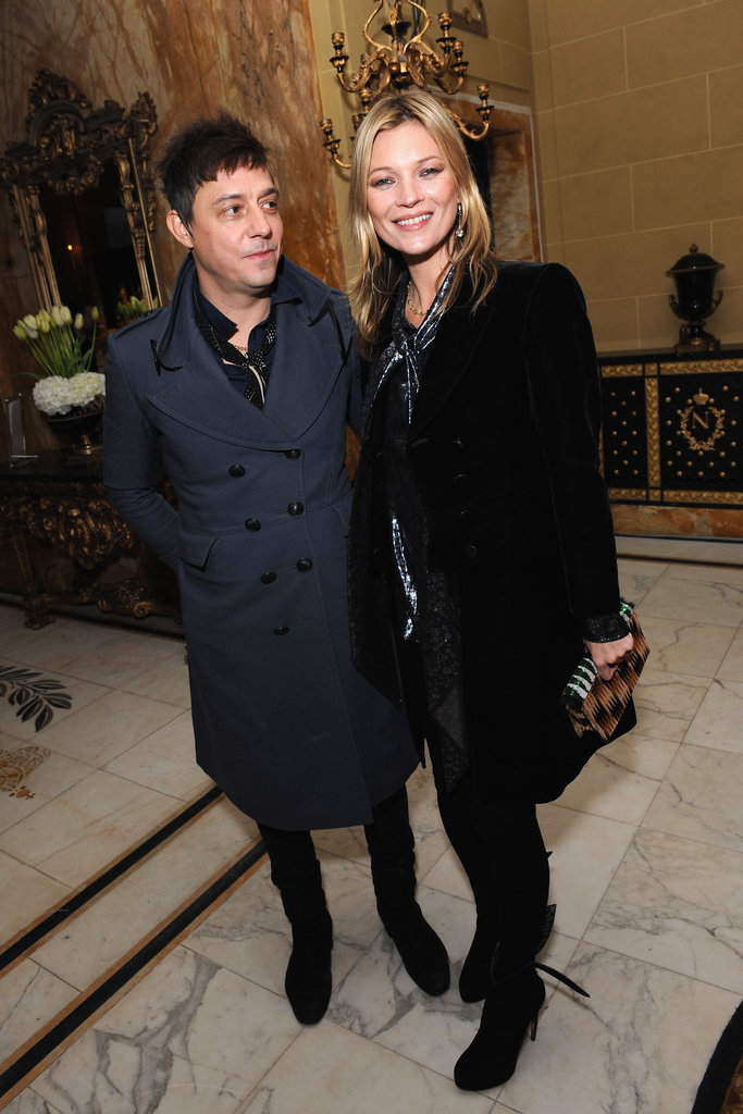 Jamie Hince gave wife Kate Moss a loving look as they posed together at Café Royal in London back in November 2012.