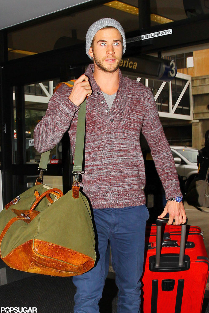 Liam Hemsworth kept warm in a marled sweater.