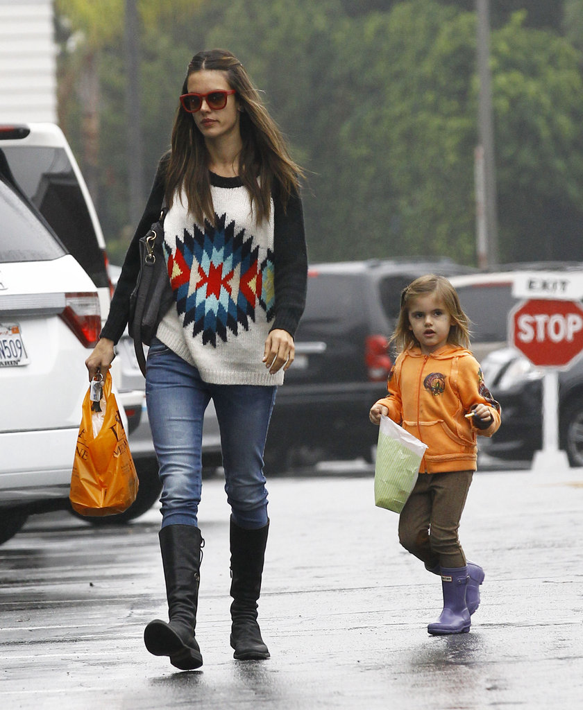 Alessandra Ambrosio and her daughter, Anja, wore rain gear.