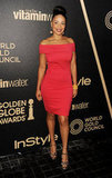 Sanaa Lathan dressed up in a hot red mini with an off-the-shoulder neckline, then finished with leopard-print platforms.