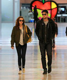 Kristen Stewart and on-again boyfriend Robert Pattinson walked through JFK airport together on November 27, as they left New York after a whirlwind trip.