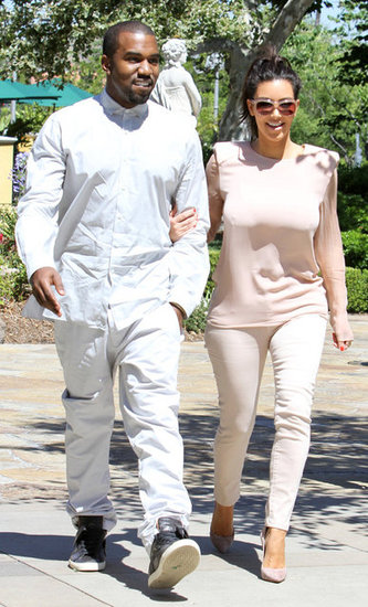 Kim Kardashian held onto Kanye West during an LA day out in June 2012.