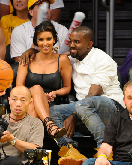 Kanye West had his arm around Kim Kardashian and a smile on his face at a May 2012 Lakers game in LA.
