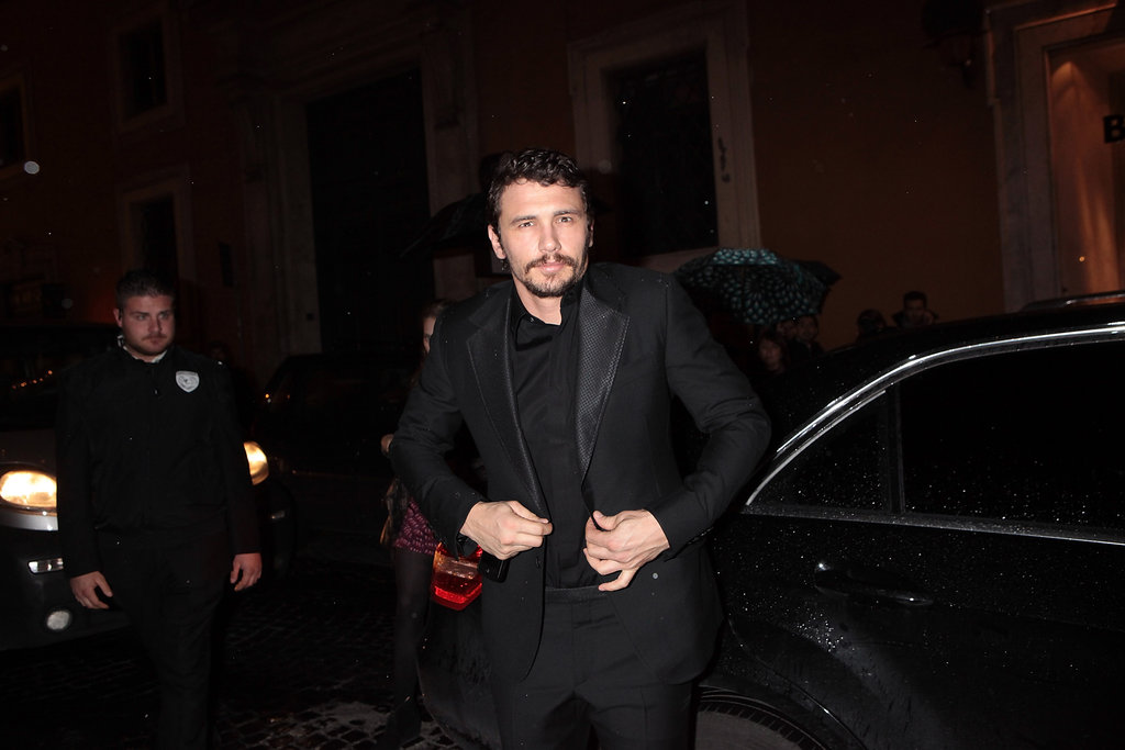 James Franco buttoned his jacket after getting out of the car.