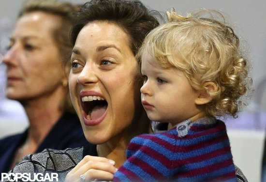 Marion Cotillard held her son, Marcel, at the Masters in Paris.