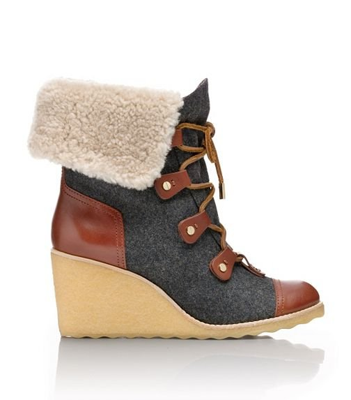 If you're looking for something that can double as a really good snow boot, without all the clunky add-ons, then it would probably look a lot like Tory Burch's Marley flannel wedge boot ($385). It's an update on a classic Alpine hiking boot, complete with shearling lining and a durable rubber sole wedge.