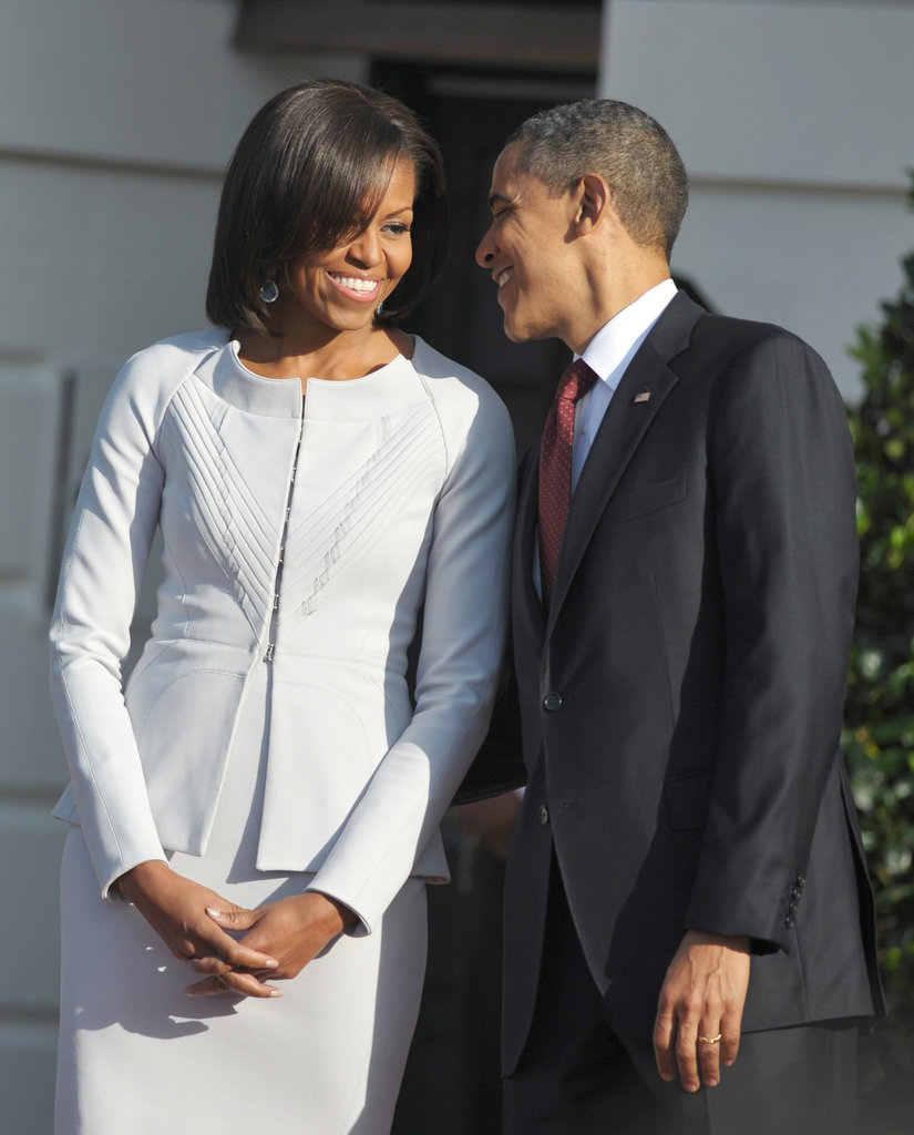 Barack leaned in and whispered something to Michelle on the South Lawn in March.