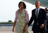 Barack had his arm around Michelle as they landed in New York.