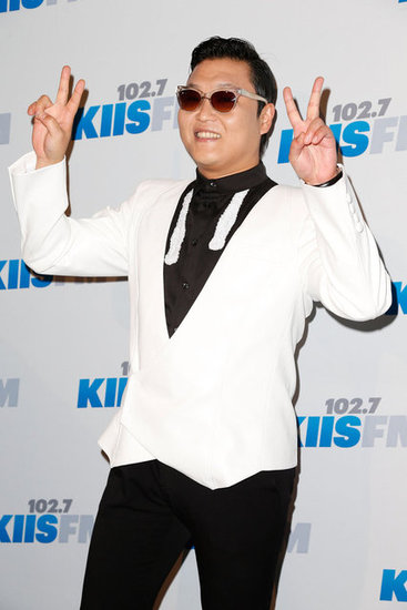 Psy posed on the red carpet at Jingle Ball.