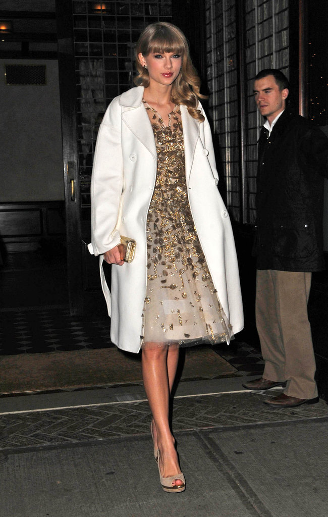 Taylor Swift kept warm in a white coat in NYC.
