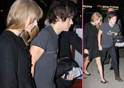 Taylor Swift and her rumored boyfriend Harry Styles hold hands while heading back to her hotel at 4am on Tuesday morning