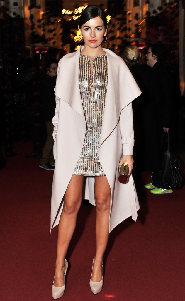 Camilla stunned us with styling savvy, pairing a hot little sequined Salvatore Ferragamo minidress with a luxe pale blush coat and nude pumps. The results? A cocktail look that's simultaneously chic as it is sexy — and perfect for the holiday party season. Click on to get the same look!