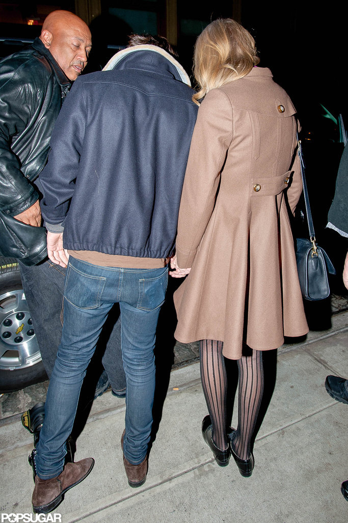 Taylor Swift wore a brown coat in NYC.