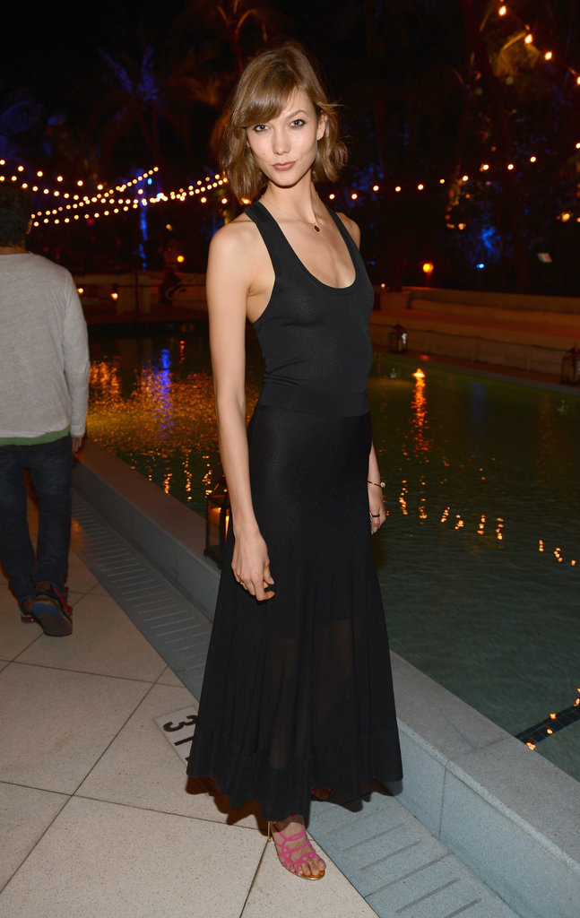 Karlie Kloss took the understated route in a slim black maxi and strappy pink heels at Chanel's Art Basel dinner.