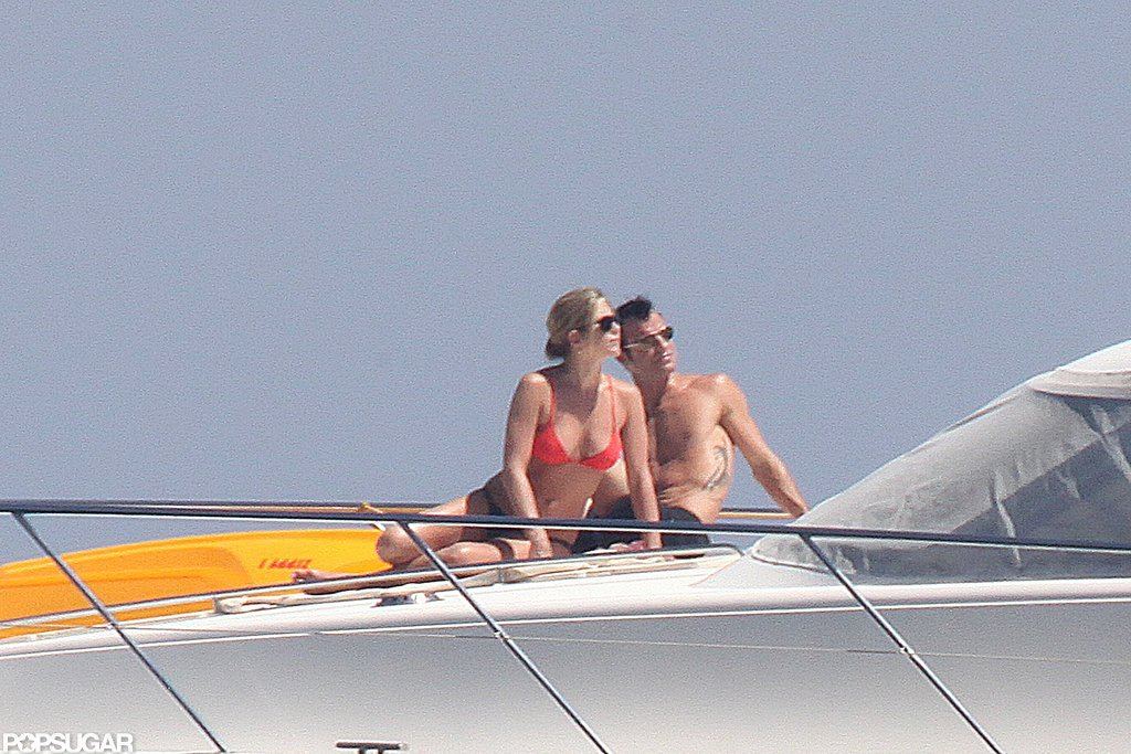 Jennifer Aniston relaxed in her bikini with fiancé Justin Theroux as they rode on a yacht in Italy this June.