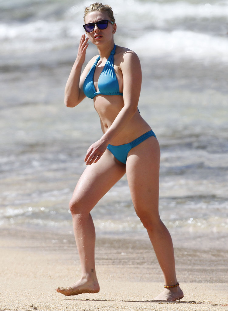 Scarlett Johansson stunned in a bright blue bikini while hanging in Hawaii this February.