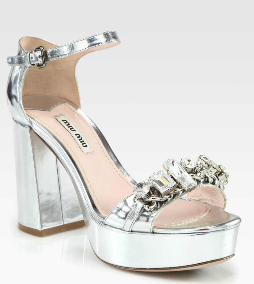 We can't stop gushing over the gorgeous jewel details on these Miu Miu Metallic Platform Sandals ($890).