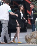 Kristen Stewart carried her high heels.