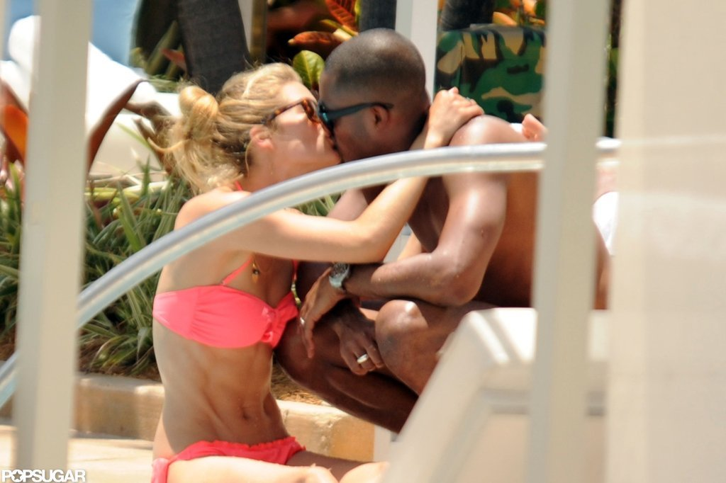 Supermodel Doutzen Kroes shared a kiss with husband Sunnery James during a June 2012 layover in Miami.