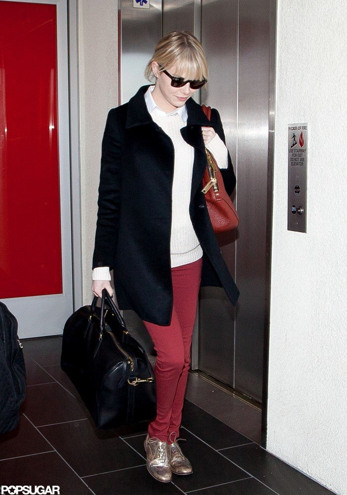 Emma Stone had her hands full as she walked through the airport.