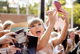 Taylor Swift took photos with her fans while arriving at the ARIA Awards in November 2012.