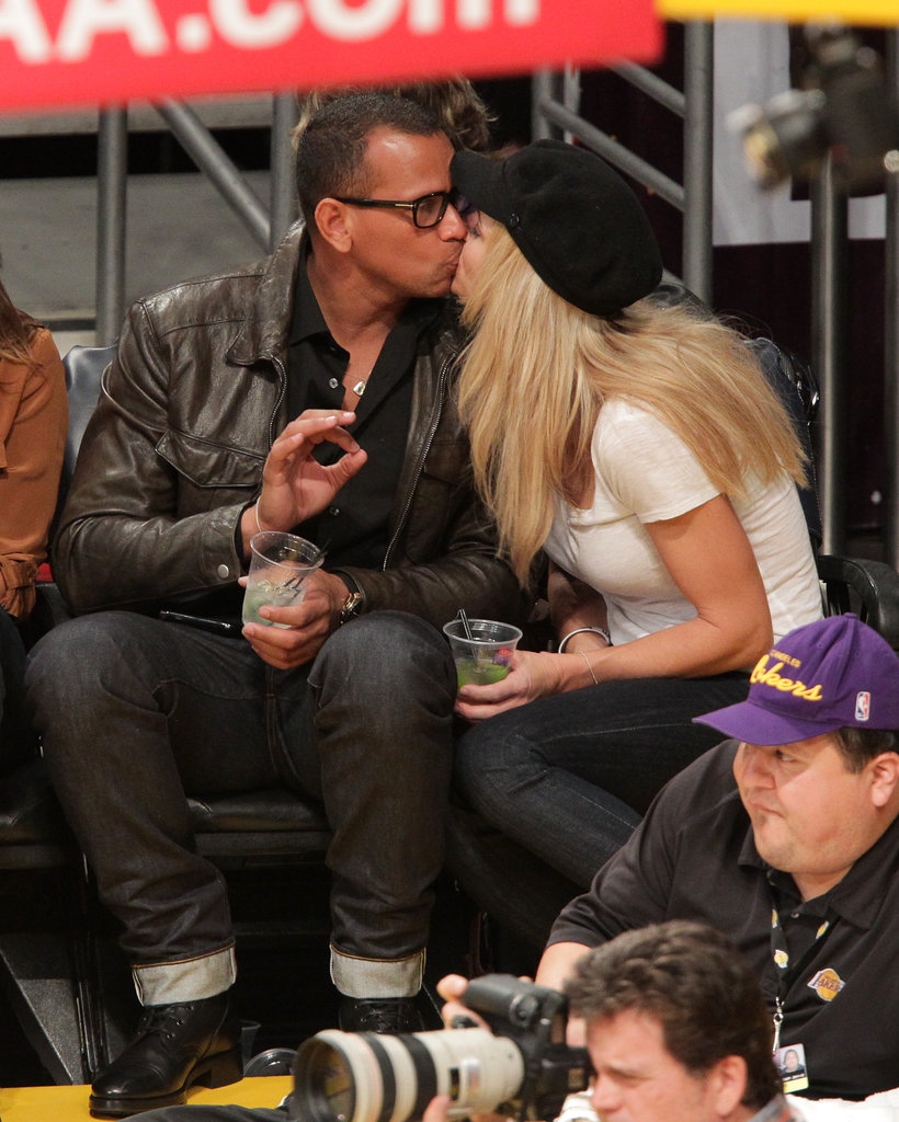 ARod and girlfriend Torrie Wilson were spotted sharing drinks and kisses during a Lakers game in January.