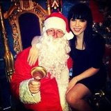 Carly Rae Jepsen sat on Santa's lap. Source: Instagram user carlyraejepsen